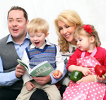 Family with young children reading
