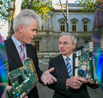 Two men holding motherboards