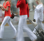 women walking with bags